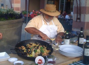 Antonio Laudisio making paella on the patio