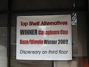 Sign on front of building at Top Shelf Alternatives