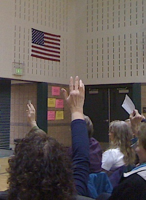 Hands outstretched in favor of Andrew Romanoff turned out to be in a minority in Precinct 128. (Reporter photo)