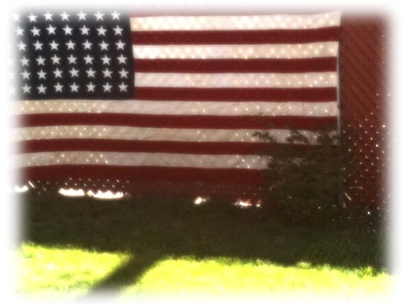 <cutline>Flag picture, taken at friend's Memorial Day picnic, was enhanced using the Photo fx app for iPhone.</cutline>