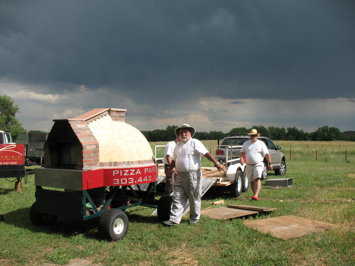The Laudisio team arrived early, under threatening skies, to set up the pizza oven.
