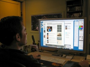 Designer Dave Wright of stormlab.com shown reworking Boulder Reporter's front page graphics recently. (Reporter photo)