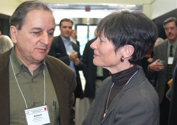 Frances Draper, right, executive director of the Boulder Economic Council, chats with Richard Foy of Boulder's Communication Arts.