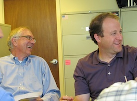 Tom Cech and Jared Polis share lighter moment